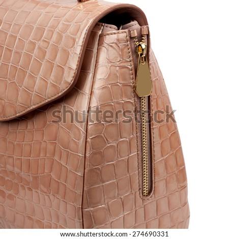 Light brown glossy handbag isolated on white background. - stock photo