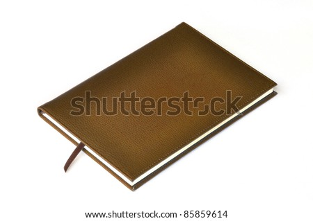 Light brown leather notebook on white background - stock photo