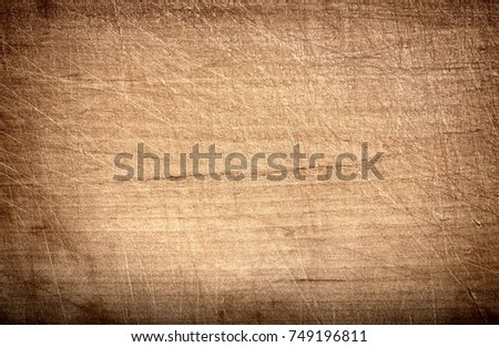 Light brown scratched wooden cutting, chopping board. Wood texture.