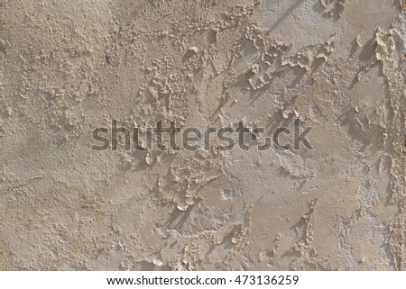 Light brown wall with flaking paint and cracks, cracked wall, wallpaper/background.
