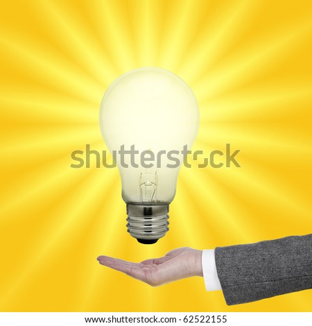 Light bulb above palm