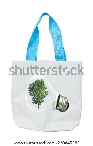 light bulb Alternative energy concept on Fabric Recycle Bag. - stock photo