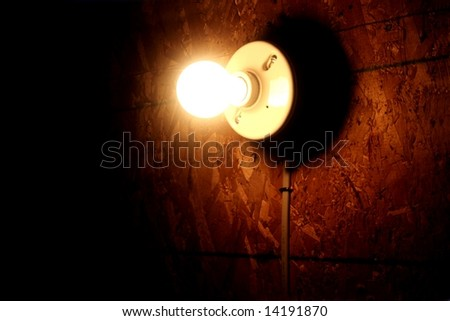 light bulb and a dark grungy background - stock photo