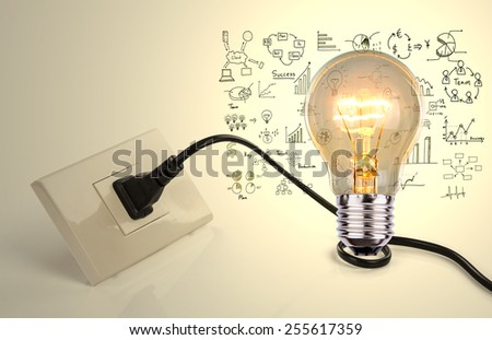 Light bulb and a plug with drawing graph - stock photo