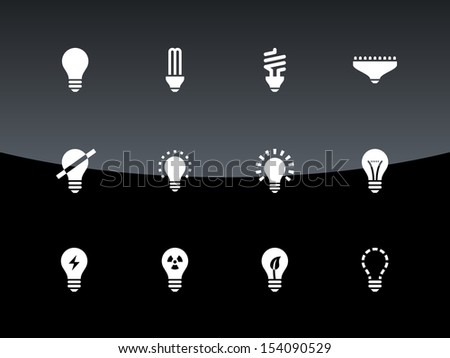 Light bulb and CFL lamp icons on black background. See also vector version.