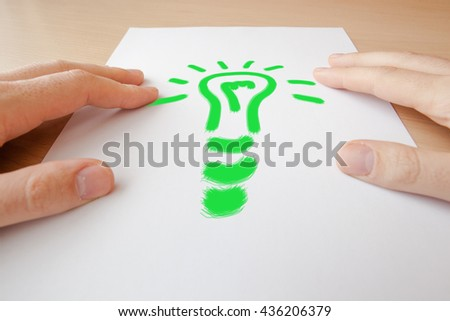 Light bulb and hand - new idea concept - stock photo