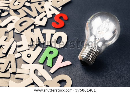 Light bulb and scattered wood letters as creative story telling for branding or awesome content concept - stock photo