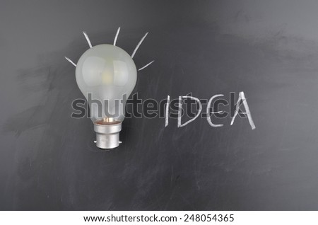Light Bulb and Writing - stock photo