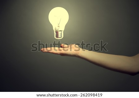 light bulb as hand - stock photo