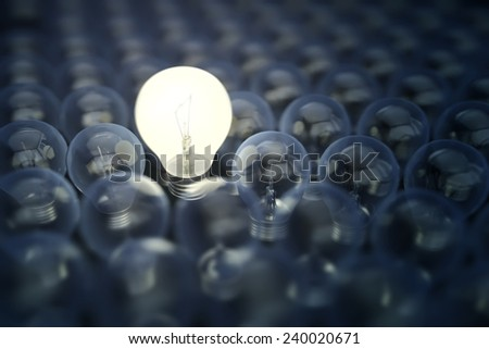 Light bulb between extinguished bulbs as creative leadership concept - stock photo