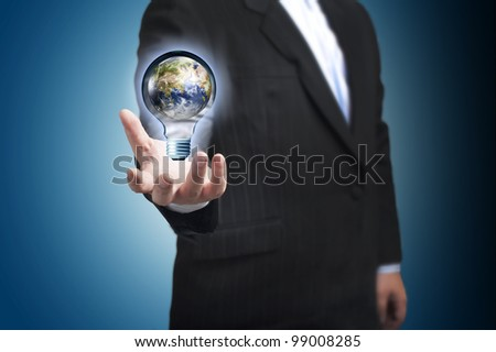 Light bulb floating on the businessman's hand. Concept for Global conservation. Elements of this image furnished by NASA - stock photo