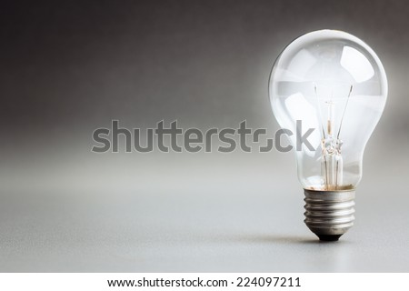 Light bulb glowing white light - stock photo