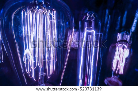 Light Bulb Ideas and Inspiration Blue Spectrum three incandescent light bulbs in a row behind glass new technology to power our future blue hue