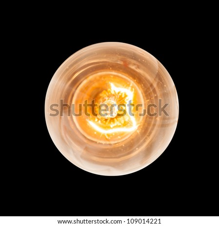 Light bulb illuminated and taken from above and isolated against black - stock photo
