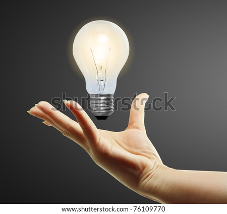 Light bulb in hand - stock photo