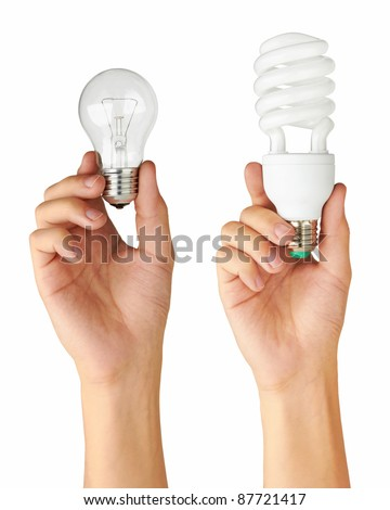 Light bulb in hand, isolated on a white background