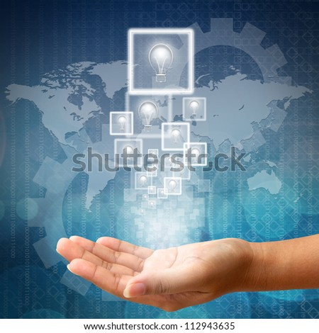 Light bulb in hand on Abstract business background blue color - stock photo