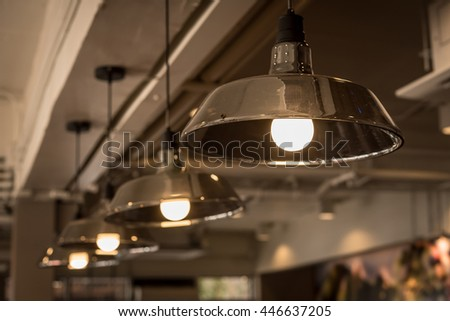 Light bulb incandescent hanging decorated interior room. Beautiful retro luxury interior bulb lighting lamp decor glowing in dark.Vintage lamp decorative in home with vintage tone.