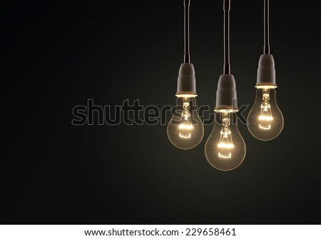 light bulb isolated on a black bakground - stock photo