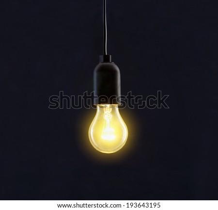 Light bulb lamp on black background - stock photo