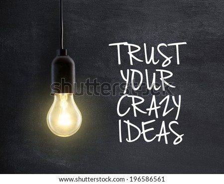 Light bulb lamp on blackboard background with idea quote - stock photo