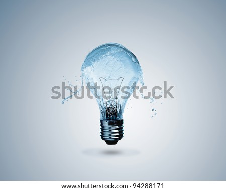 Light bulb made of water splashes - stock photo