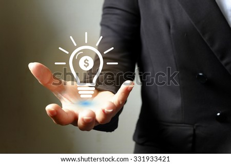 light bulb money on hand business woman , Business idea concept - stock photo