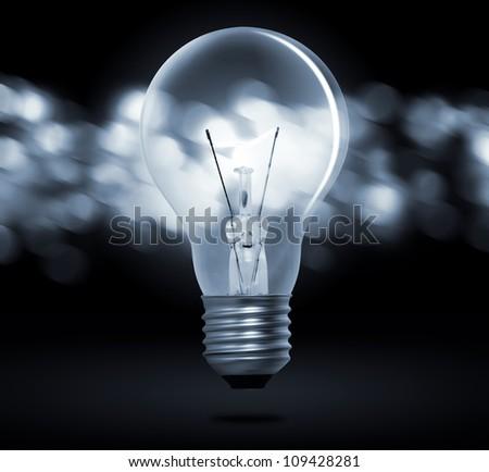 light bulb on a blue - stock photo