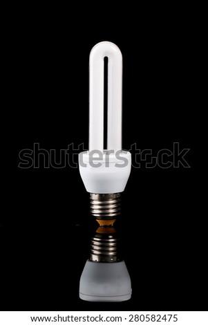 Light bulb on black background - stock photo