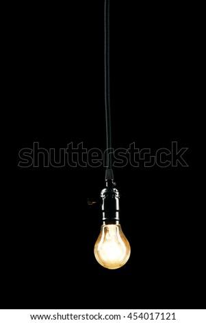 Light bulb on black background, close up - stock photo