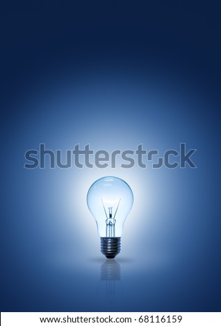 light bulb on blue background vertical. - stock photo