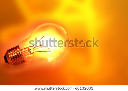 Light bulb on bright background - stock photo