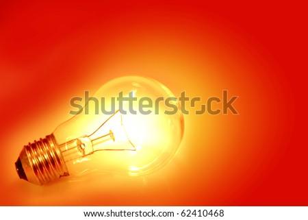 Light bulb on bright background - stock photo