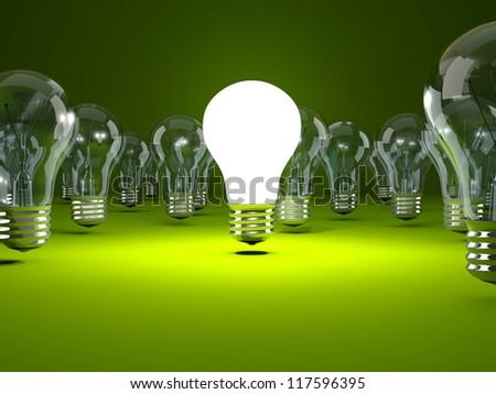 Light bulb on green background - stock photo