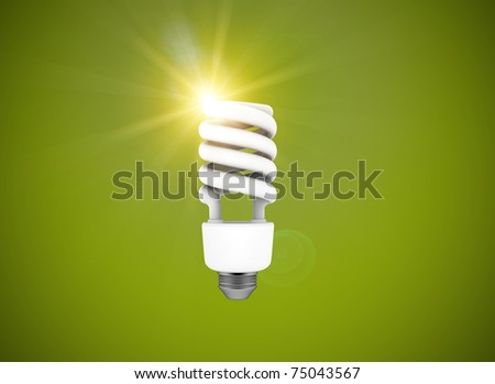 Light bulb on green background - stock photo