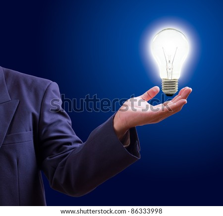 light bulb on hand - stock photo