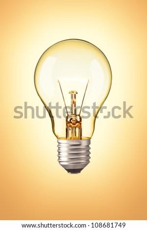 Light bulb on orange background , Realistic photo image - stock photo