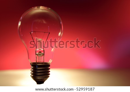 Light bulb on red background - stock photo