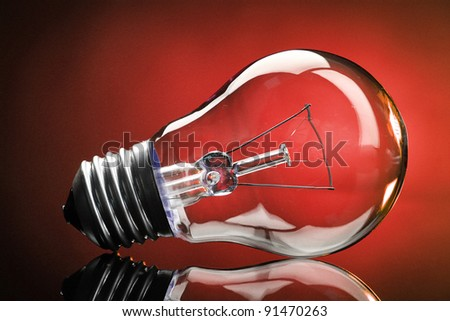 Light bulb on red background