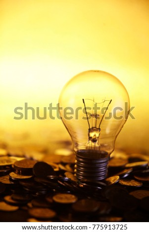 light bulb on top of coins