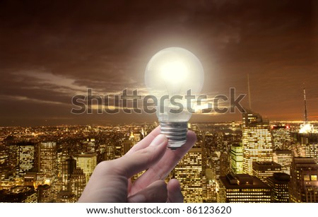 Light bulb over a night view of a big city - stock photo