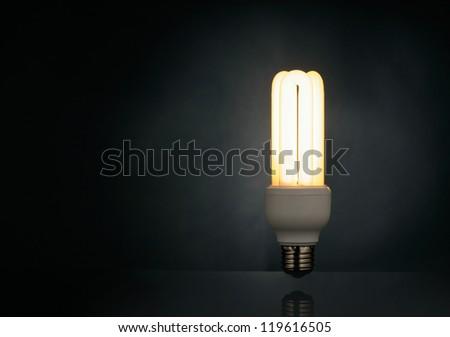 Light bulb over black background - stock photo
