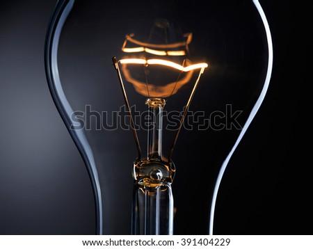 Light bulb over dark background - stock photo