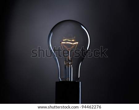 Light bulb over dark background - stock photo