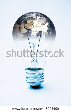 Light bulb & planet earth (courtesy of NASA) global power concept - image is supposed to be quite stark & contrasty - stock photo