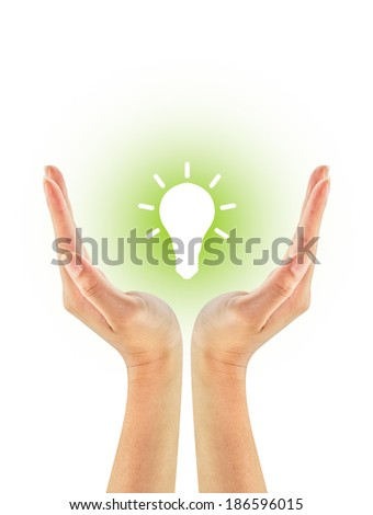 Light bulb shape on woman hands isolated on a white background. Green eco energy concept. - stock photo
