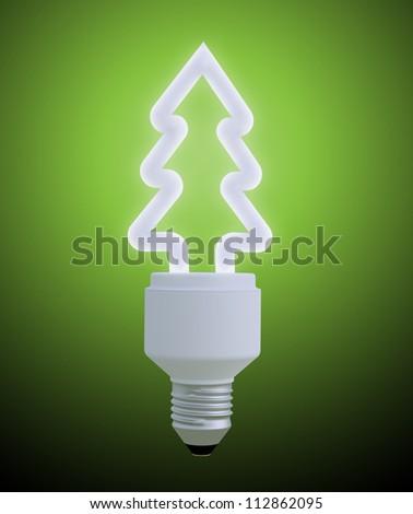 Light bulb shaped like a Christmas tree - stock photo