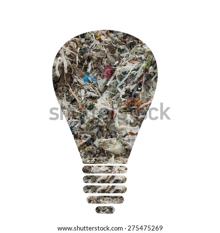 Light bulb silhouette made of municipal waste as concept for alternative energy - stock photo