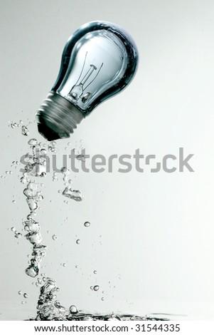 Light bulb underwater - stock photo