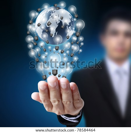 Light bulb with a globe in his hands - stock photo